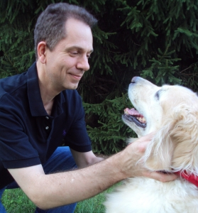 Veterinarian Dr Zeltzman looks fondly on at his labrador retriever.