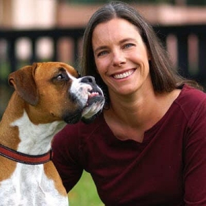 Veterinarian Dr. Coates poses with her boxer.